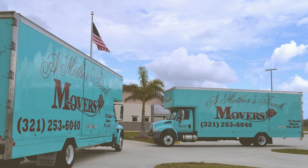 A Mother's Touch Movers Trucks in front of school